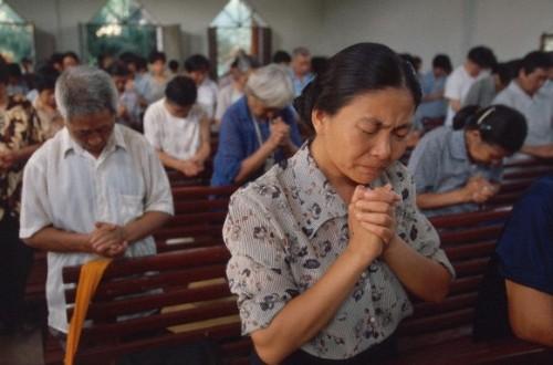 cristianos en iglesia de china