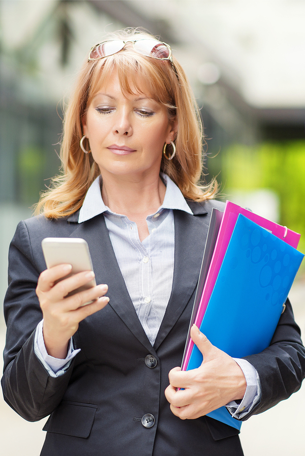 Business person using mobile app.