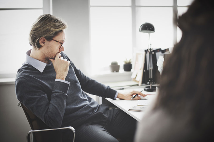 man contemplating outsourcing inside sales