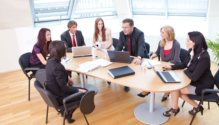 Business meeting around a conference table
