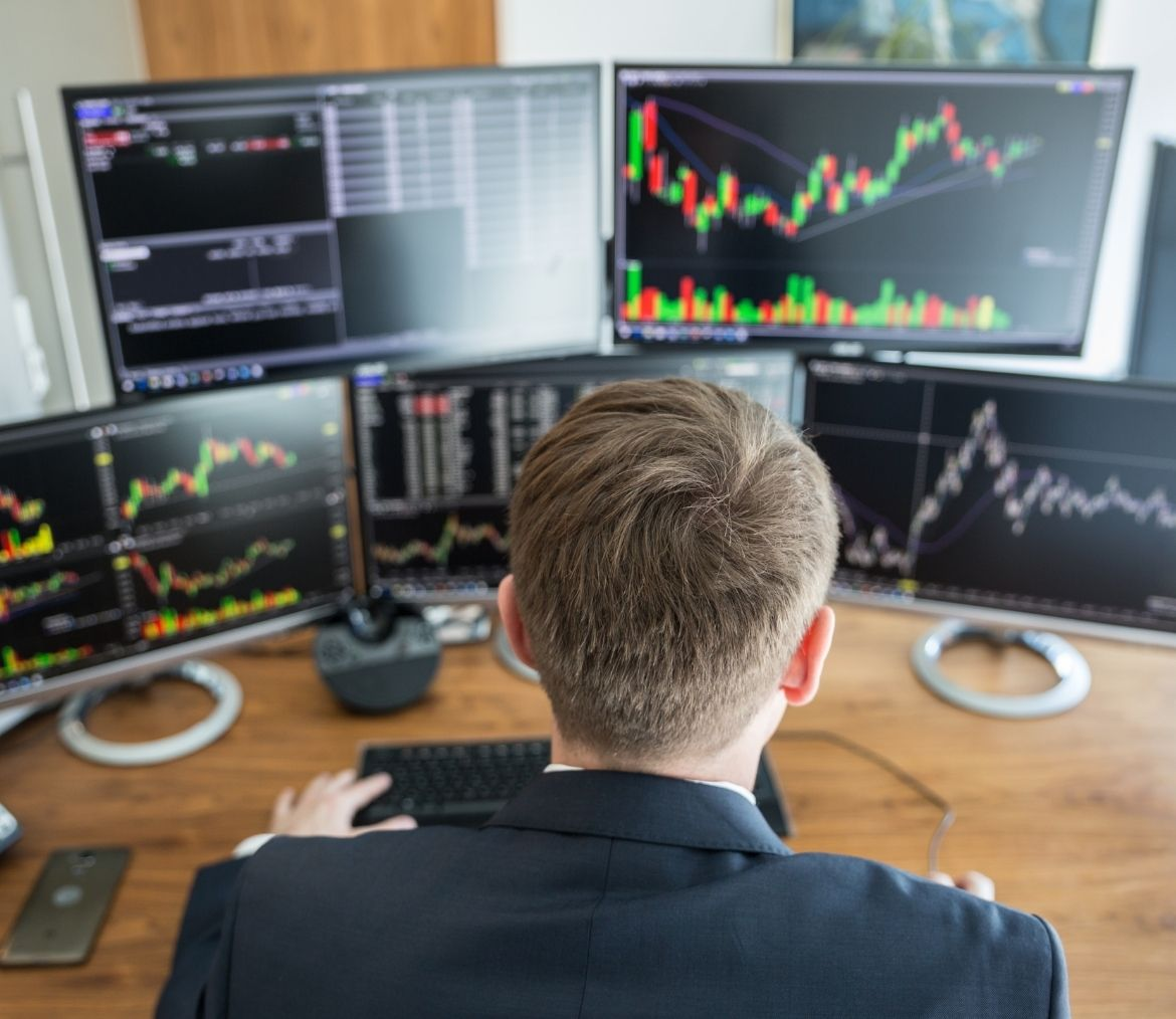 A business man stock trading on a dekstop computer