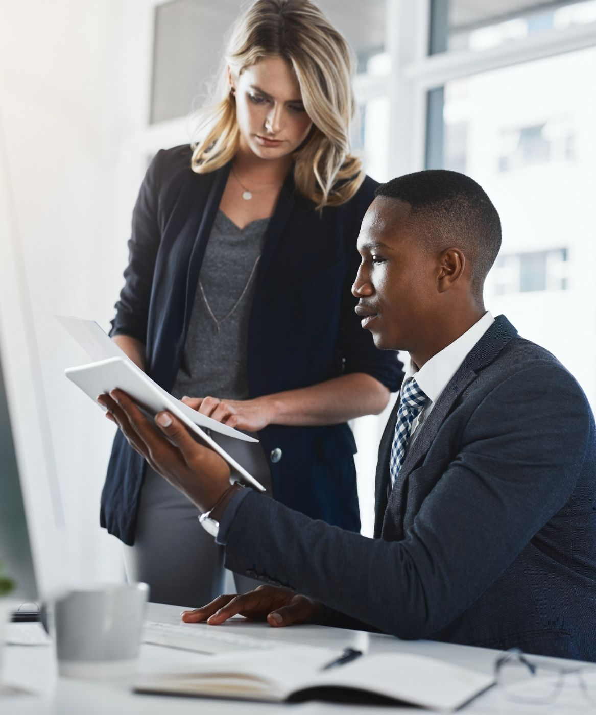 A business man and woman looking at a report.
