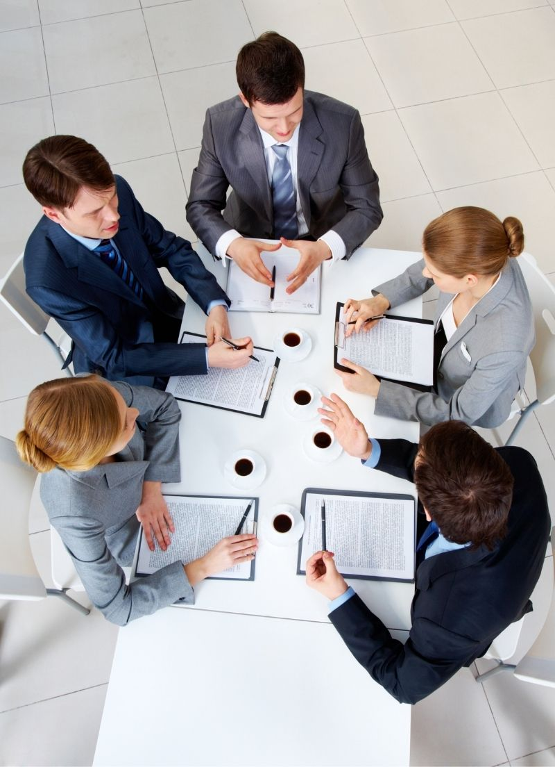 A group of finance professionals in a meeting together.