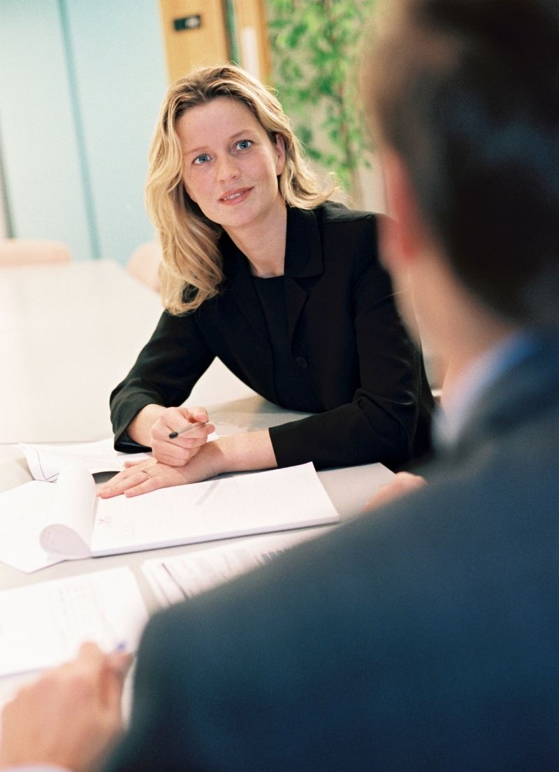 A woman in a one on one meeting