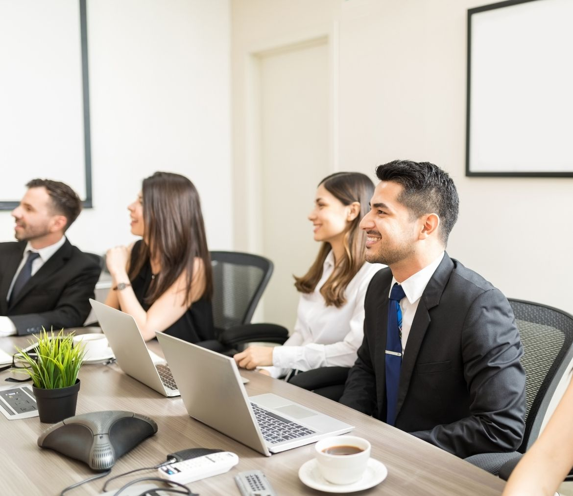 A group of c-suite executives in a board meeting