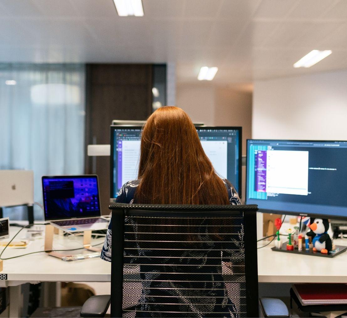 A software engineer coding on a desktop computer