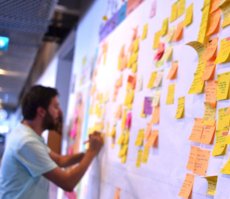 A man planning a Portfolio BI cloud migration project