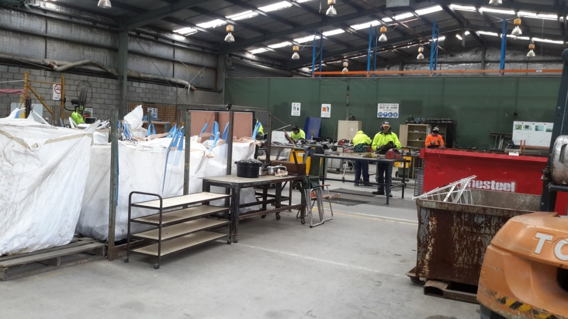 Figure 3. Disassembly of used electronics at Organisation C, a disability employer contracted by local governments to run waste transfer facilities on Council land.