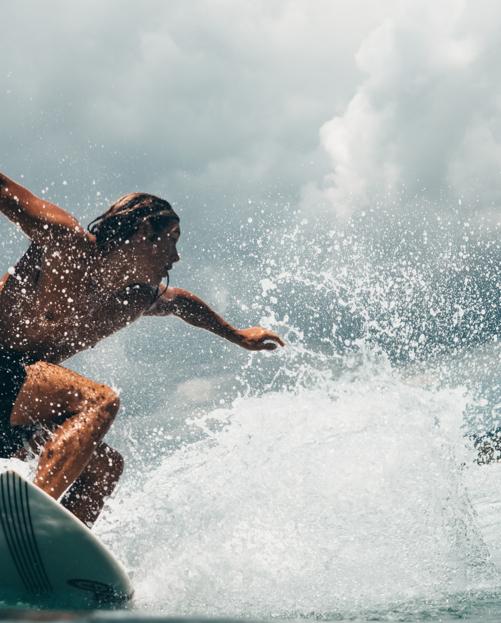 Man surfing in sunshine.