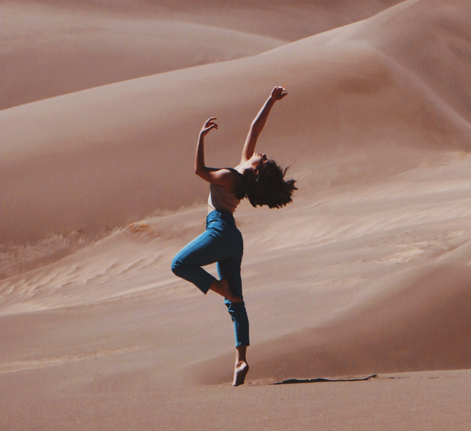 Woman dancing in the desert.