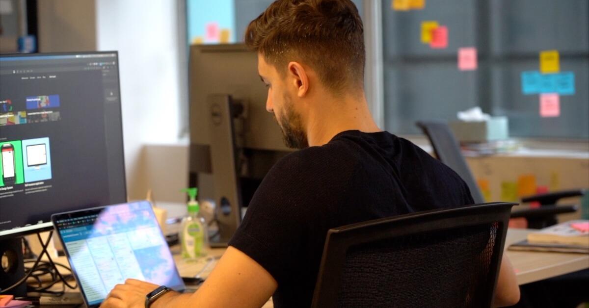 Ruben working at his laptop