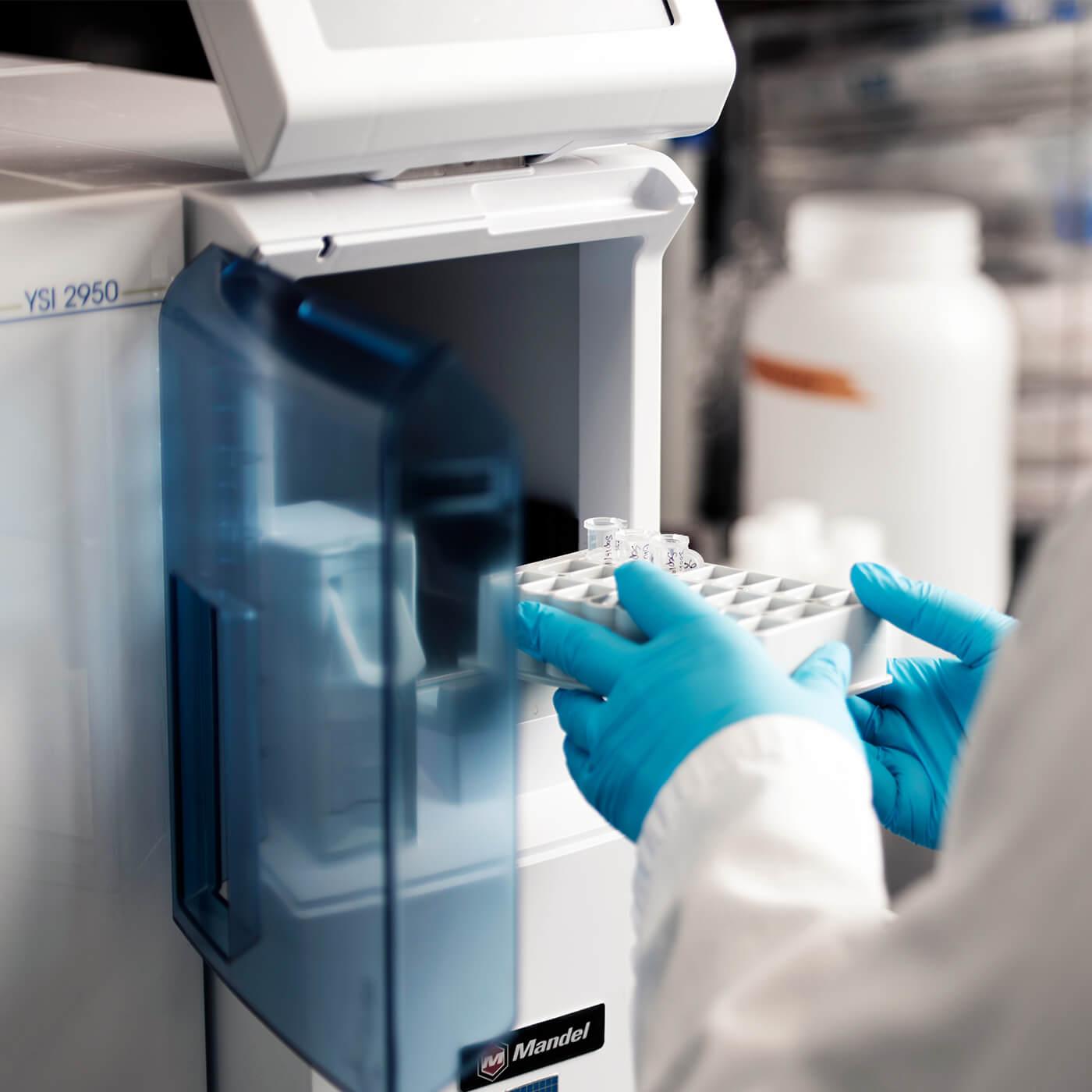 A scientist using a biochemistry analyzer