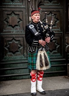 Traditional Edinburgh bagpipe at festival playing