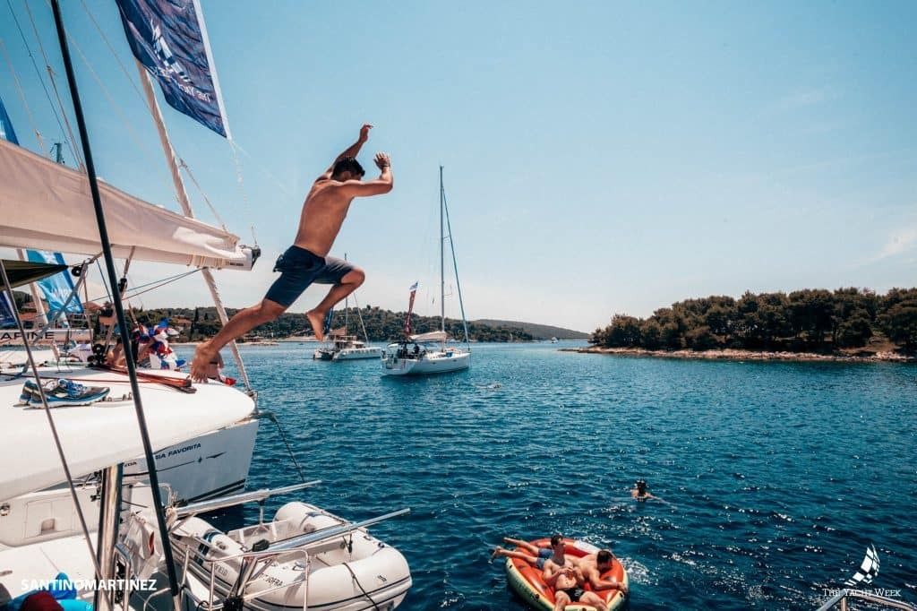 Dive jump into the ocean with the yacht week