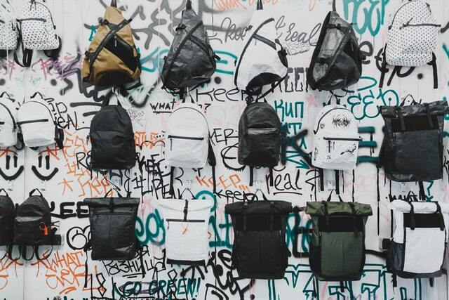 Different types of backpacks on a wall