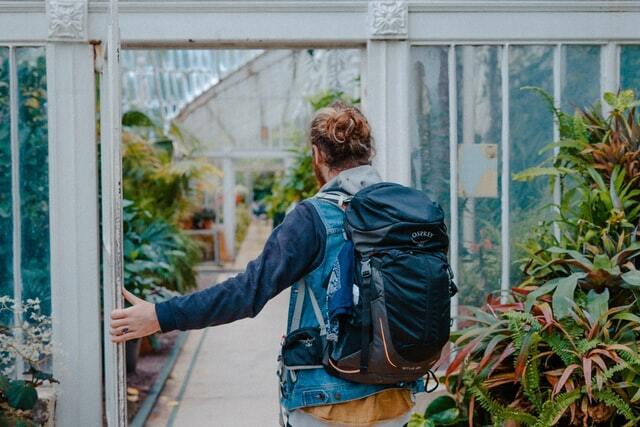 Backpacking traveler exploring a garden