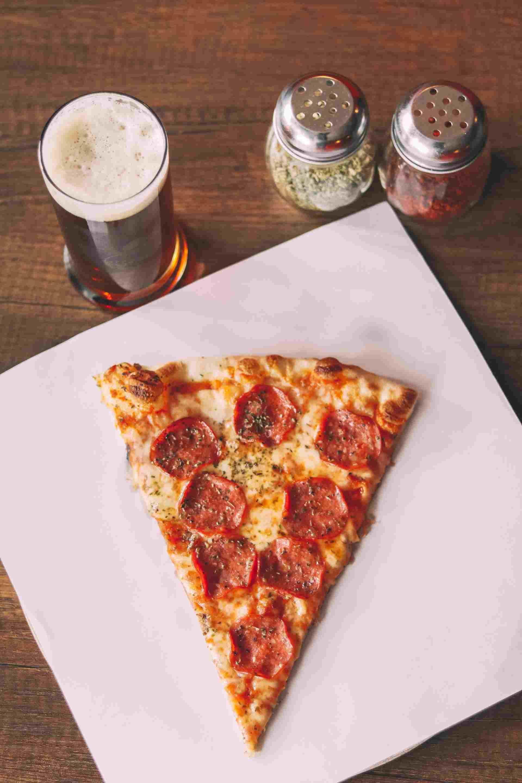 A tasty slice of pizza in rome.