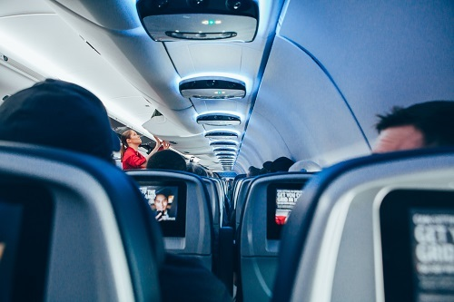 Traveling on an airplane with cheap flights from YYZ Deals.