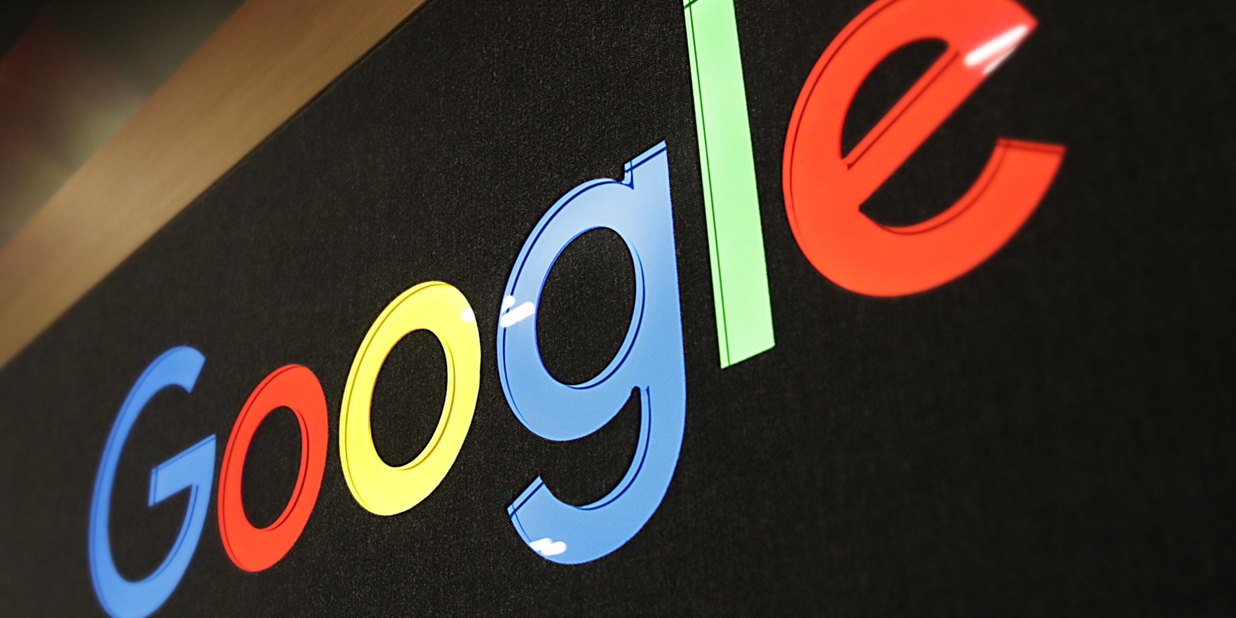 Colorful Google logo on display above Google shop