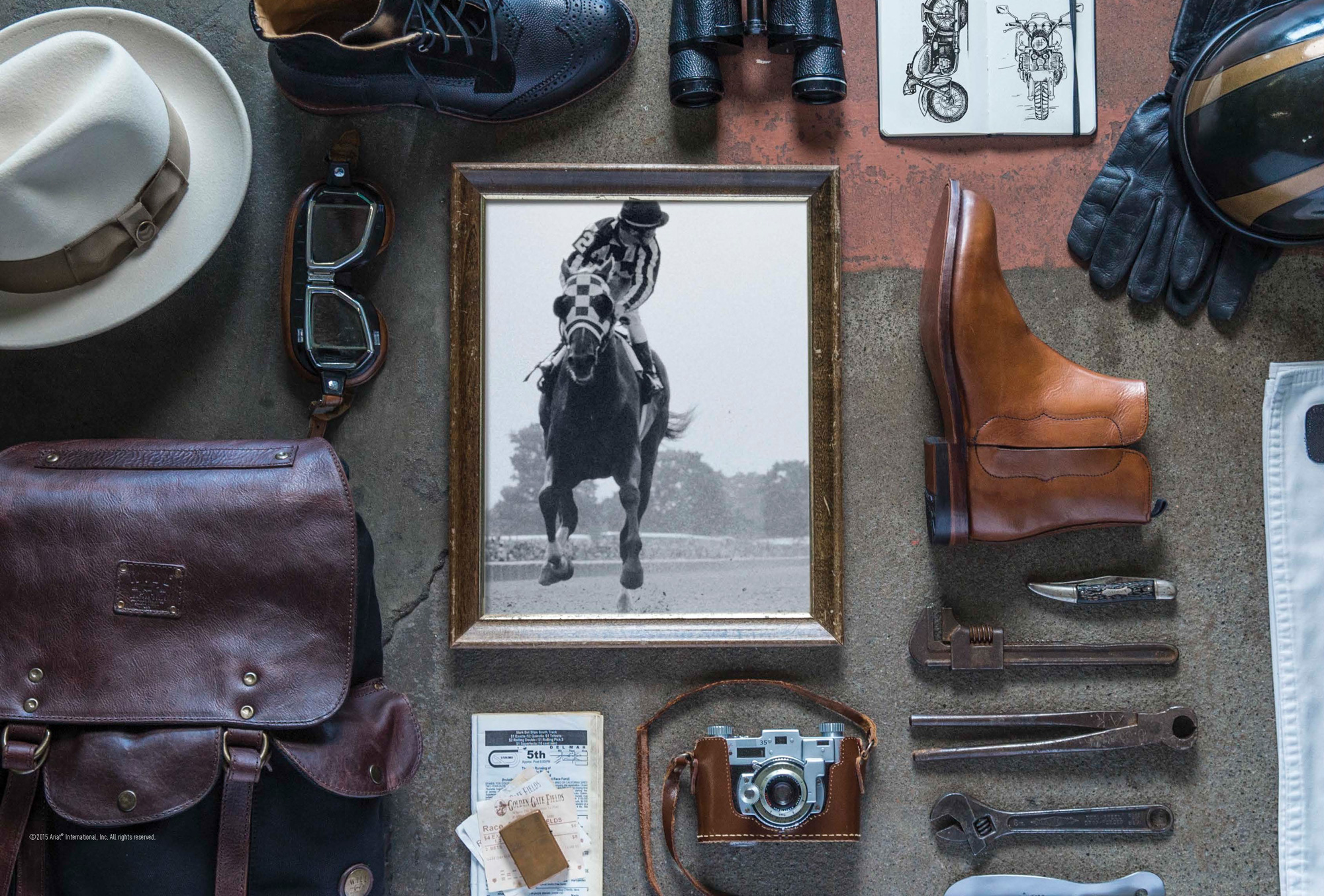 An assortment of vintage gadgets, framed photo of horse, and fashionable Ariat Two 24 boots