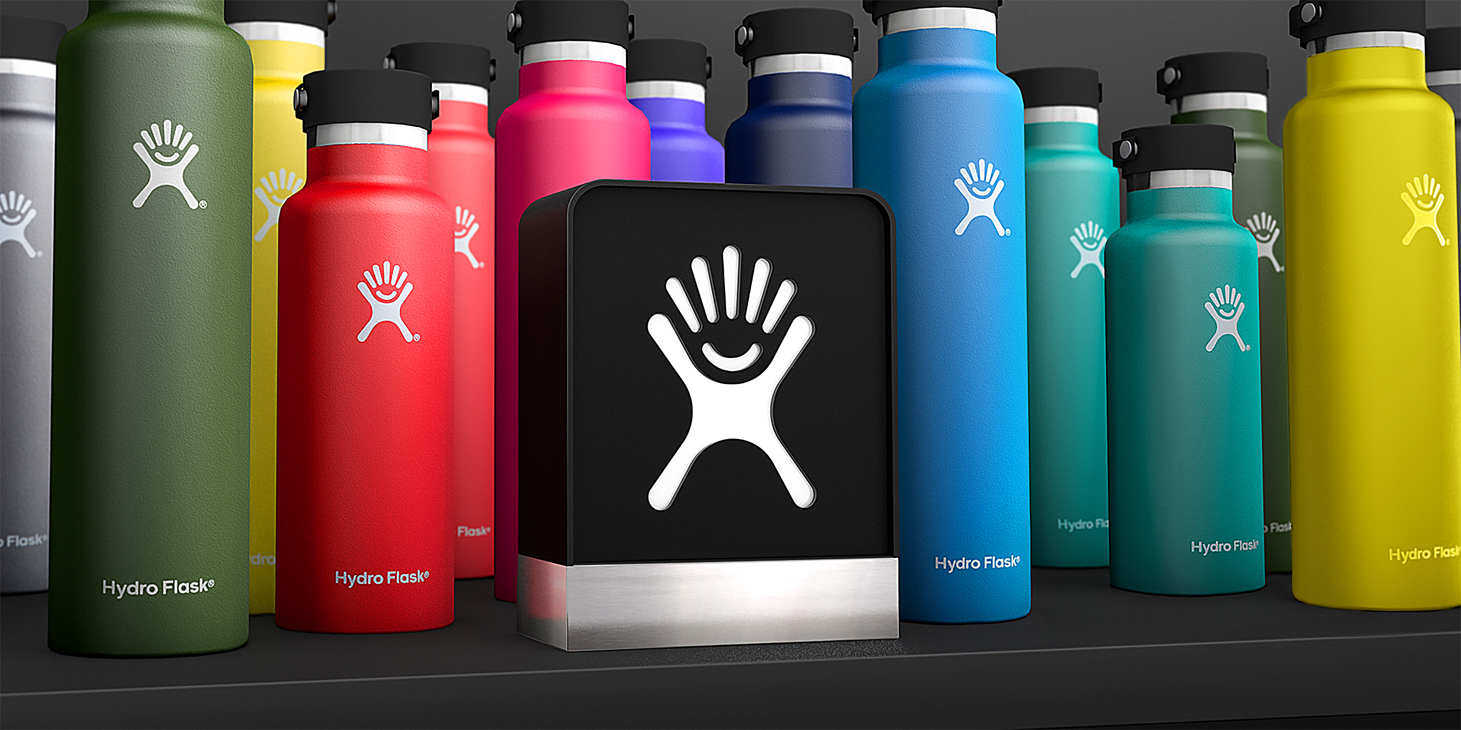 Multiple hydro flask bottles presented in different colors.