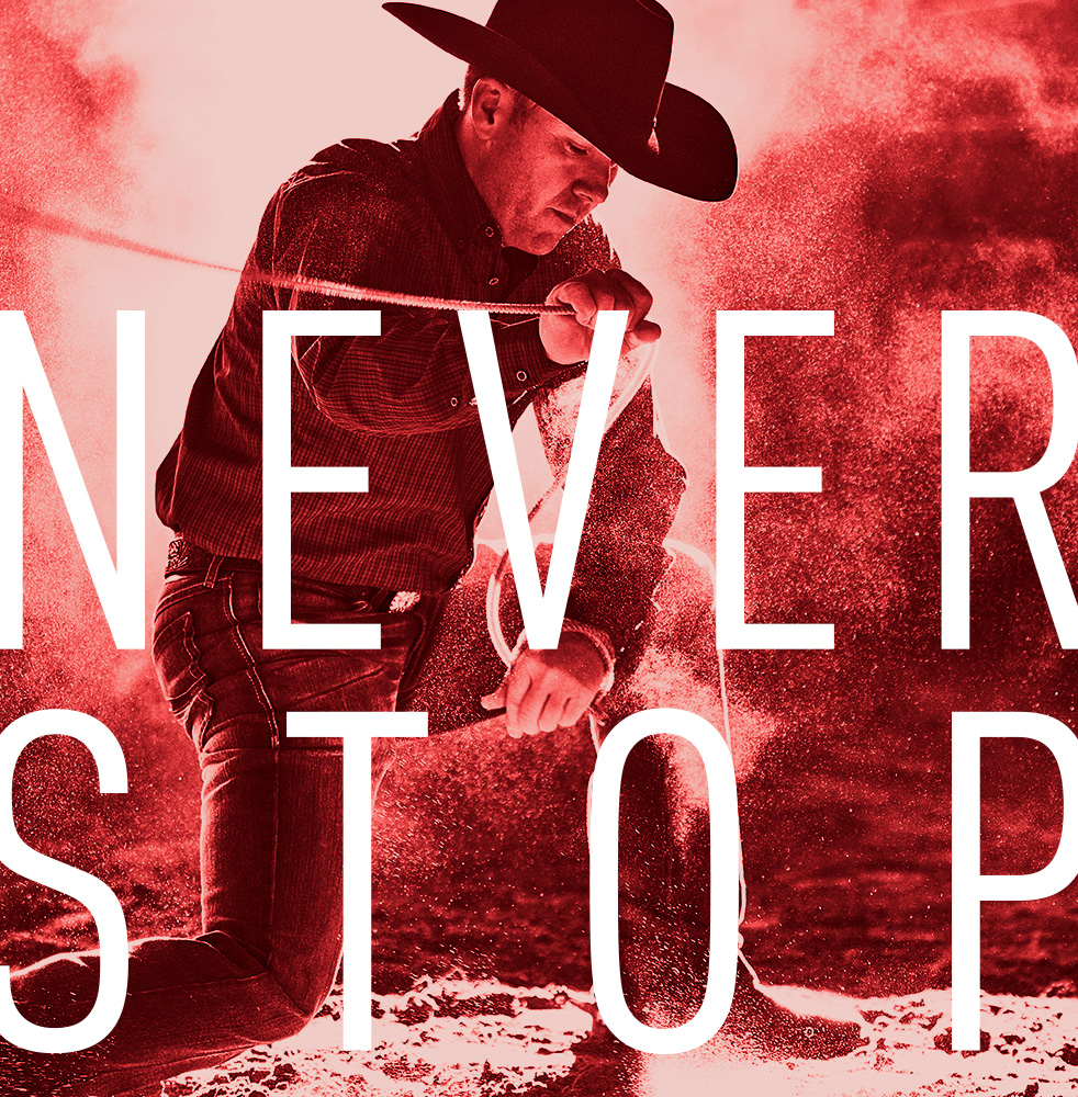 """Man in cowboy attire grappling rope with words """"never stopped"""" over red toned image"""