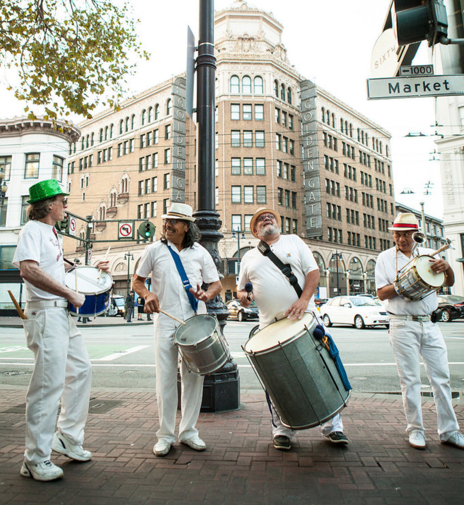 Group of musicians playing music on Market Street in SF