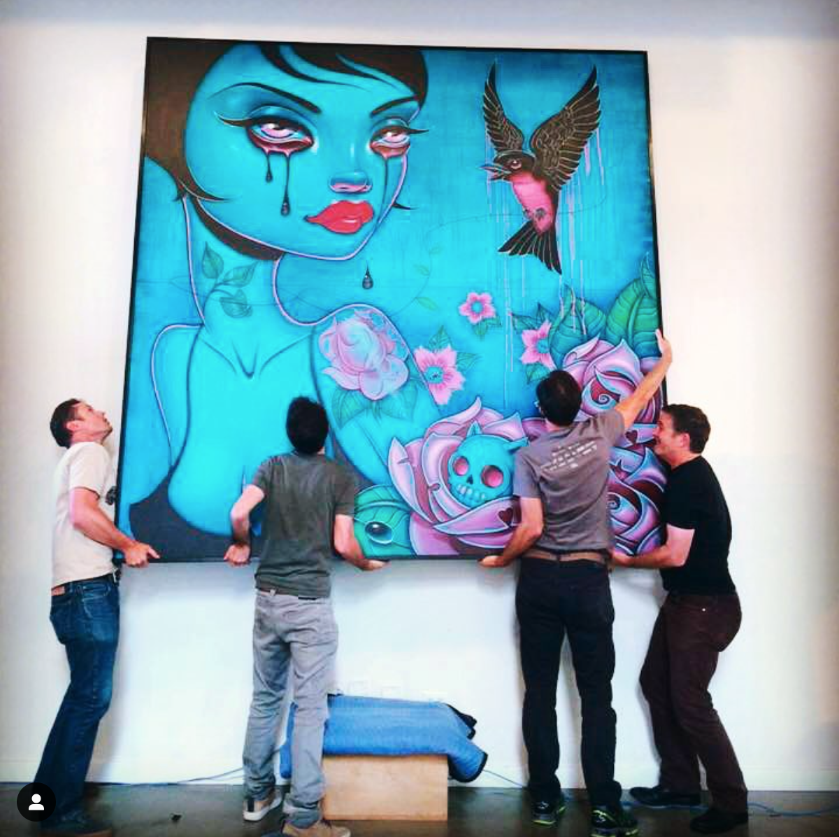 VehicleSF office team hanging out large painting