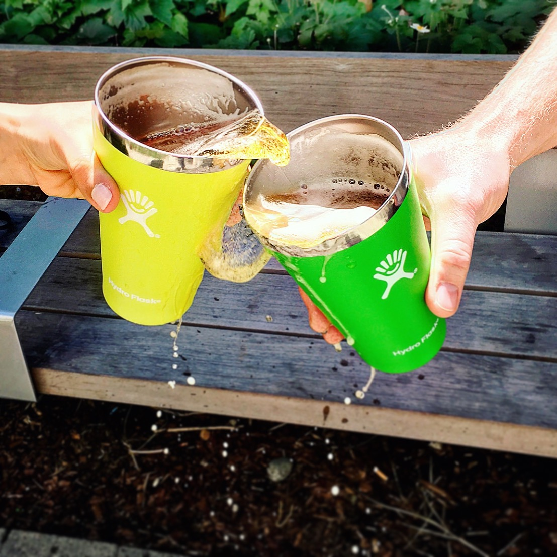Two hydro flasks splashing together