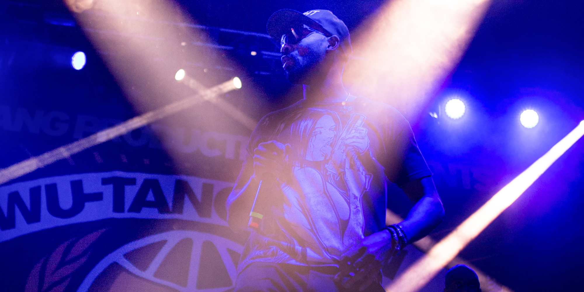 Dramatic image of RZA performing at concert
