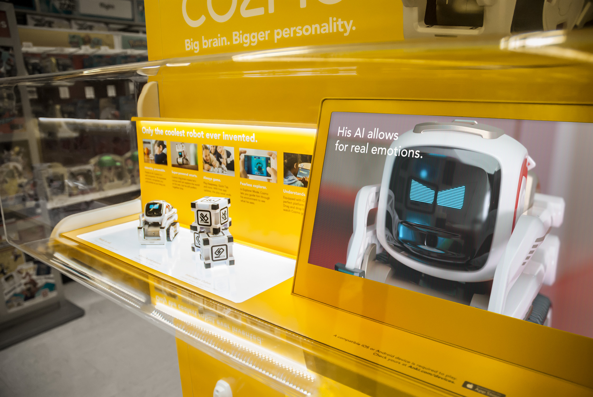 Cozmo the small AI robot on product display highlighting his emotional capabilities