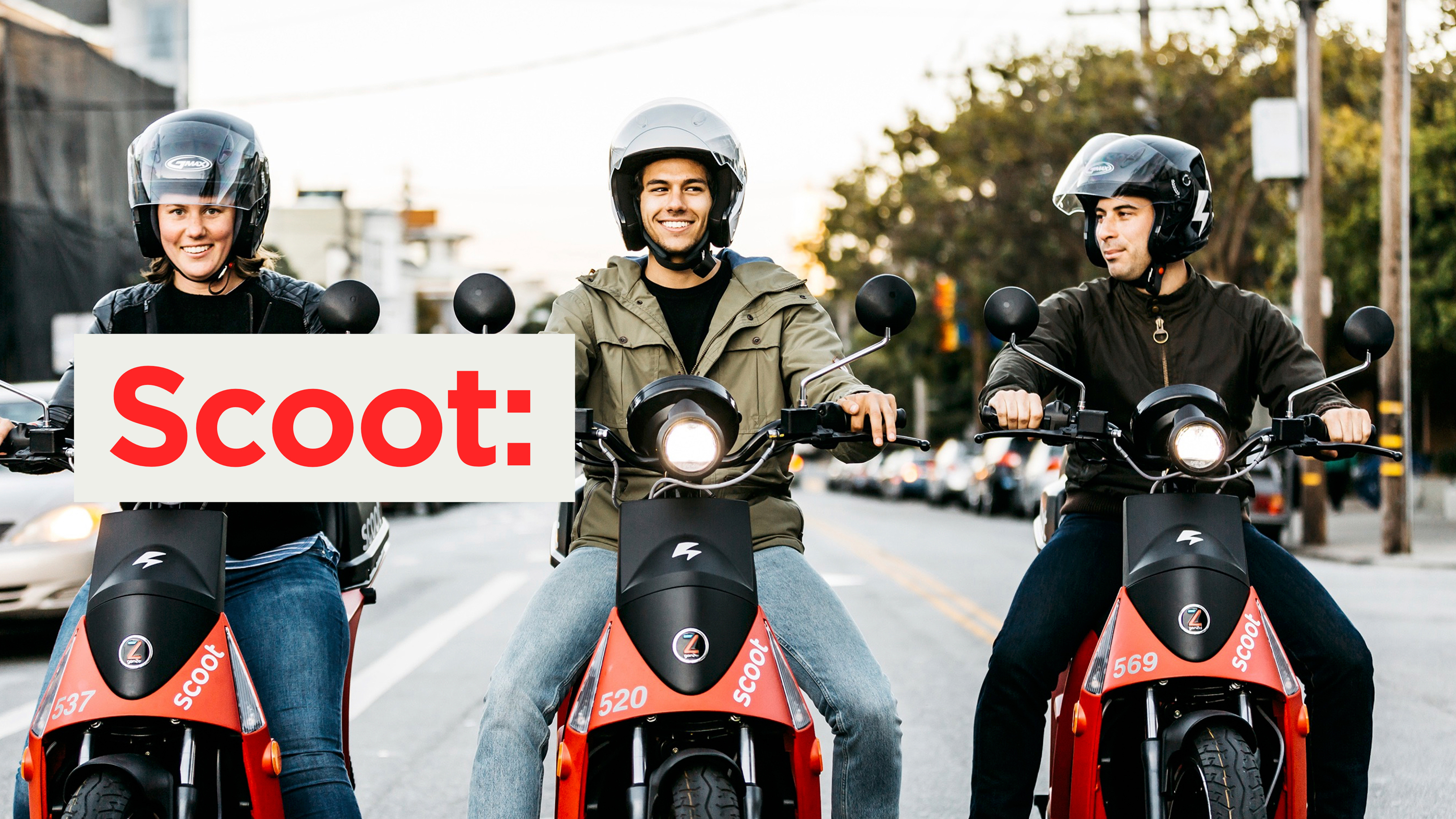 3 people riding scooters with scoot logo imposed on top of the image