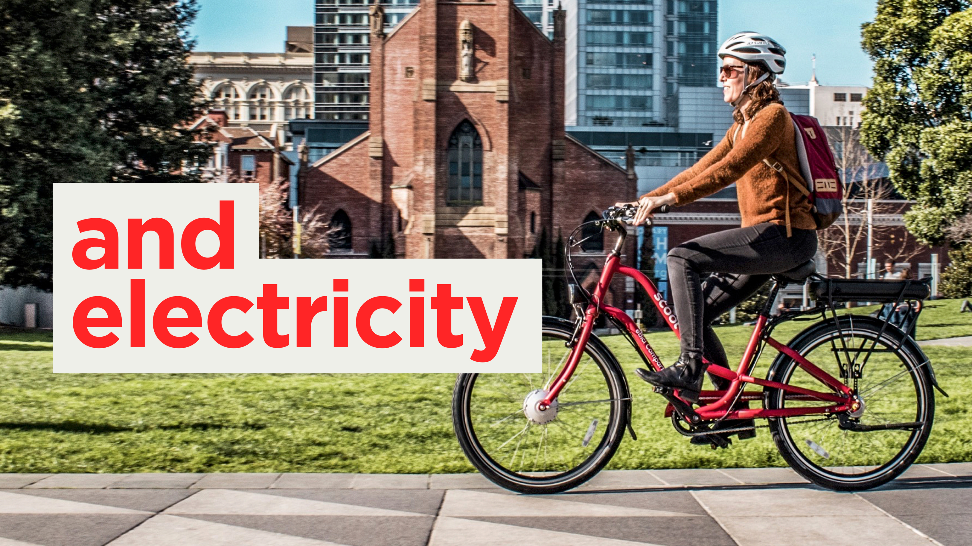 """A person riding an electric bicycle with typography imposed over the top of it saying """"...and electricity"""""""