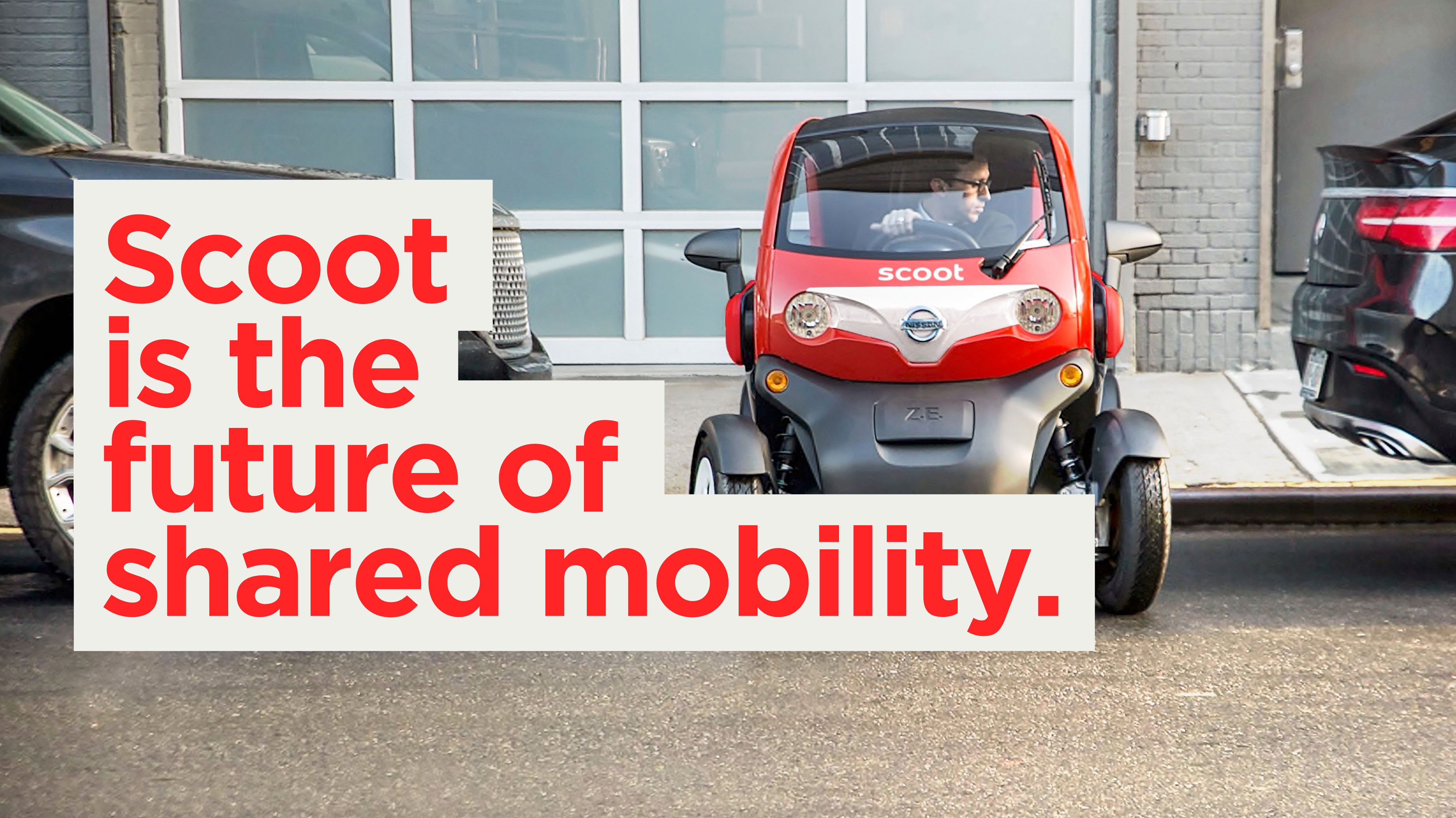 """Scoot electric vehicle being parked with typography imposed on top of it that says """"scoot is the future of shared mobility."""""""