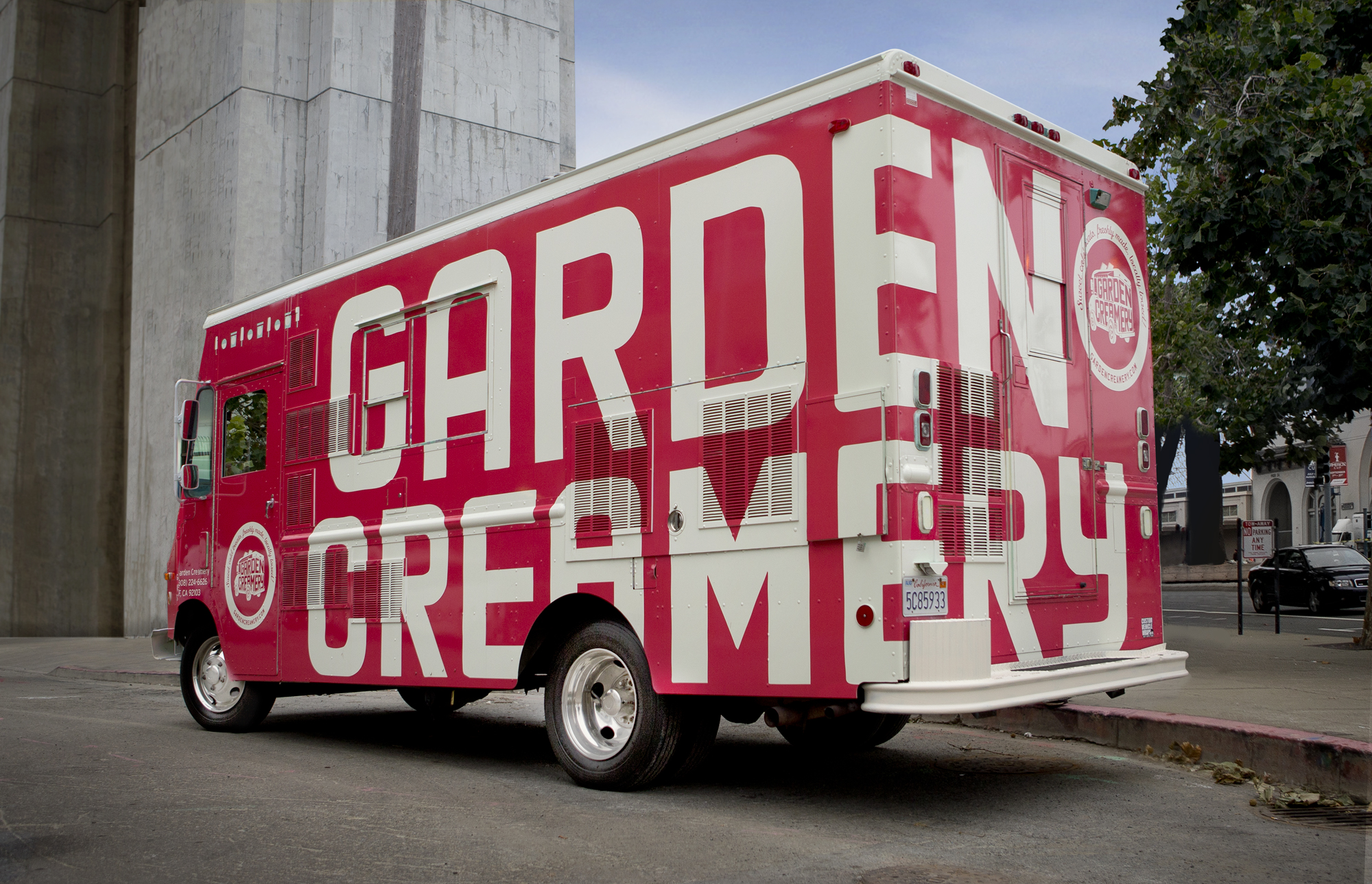 Garden Creamery mobile ice cream truck with pink super graphic wrapped around the side if the truck