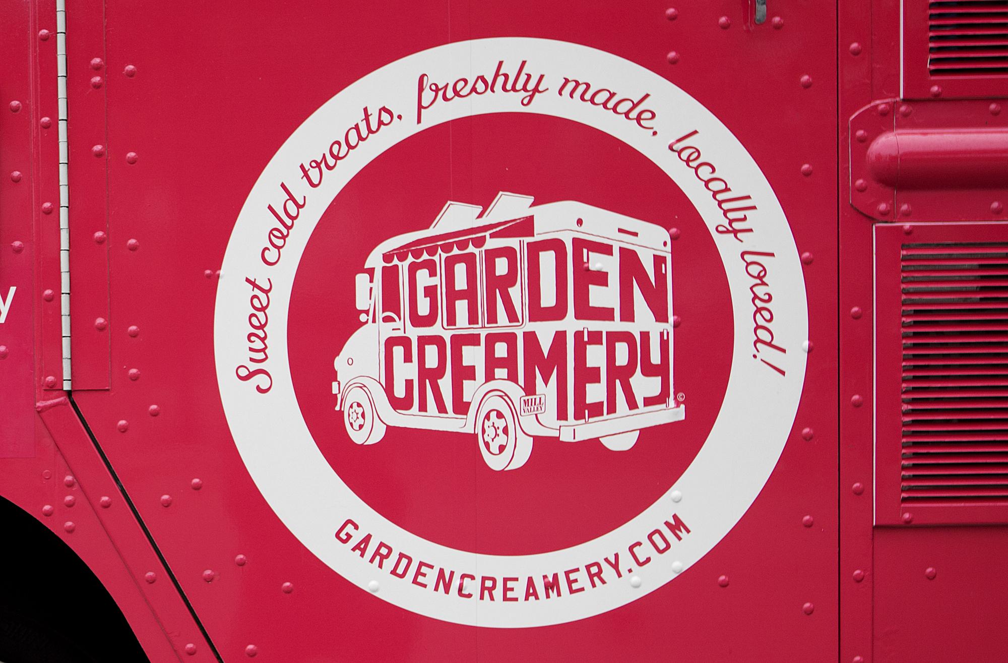 Garden Creamery mobile ice cream truck logo in pink and white