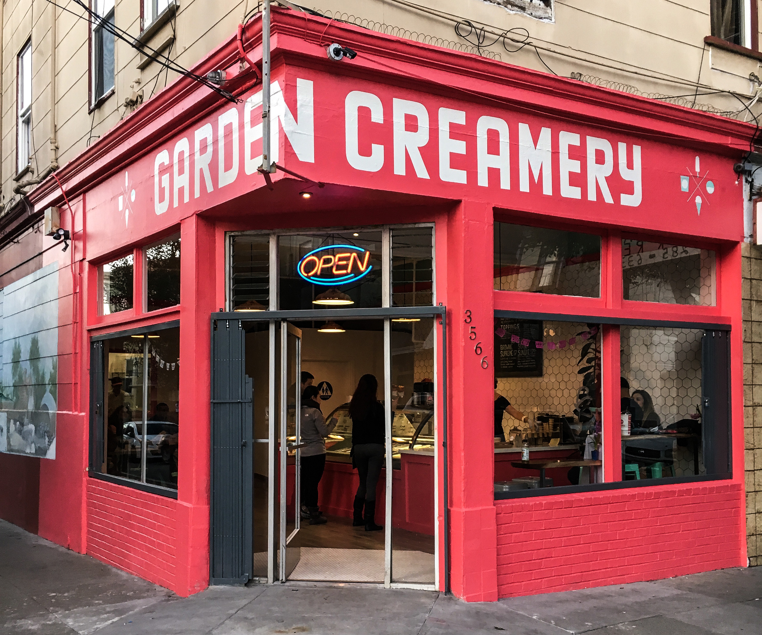 Garden Creamery storefront with pink super graphic wrapped around the side of building
