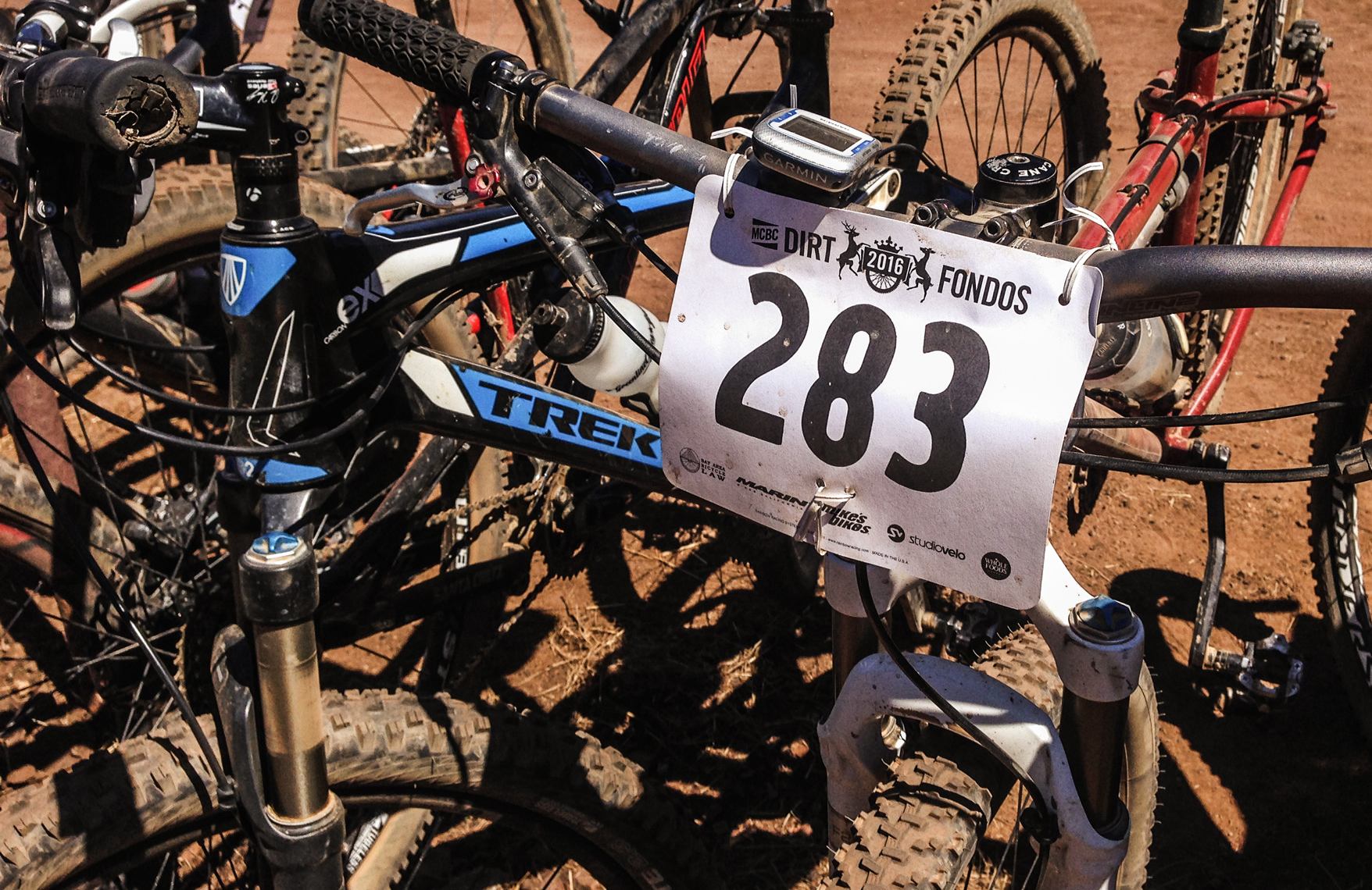 Race number on front of mountain bike with Dirt Fondo logo