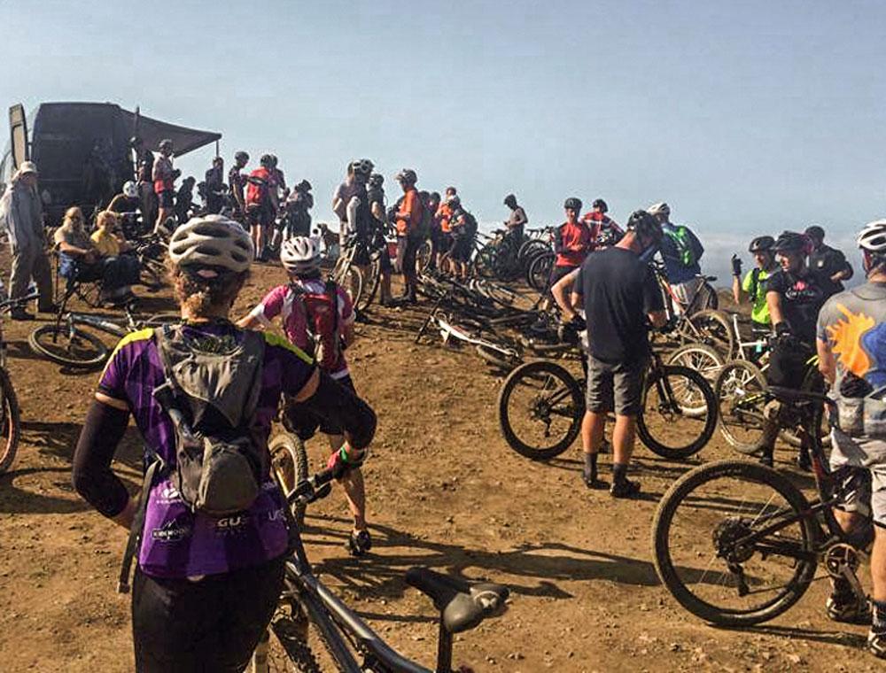A big group of mountain bikers taking a break from riding at Dirt Fondo mountain biking event