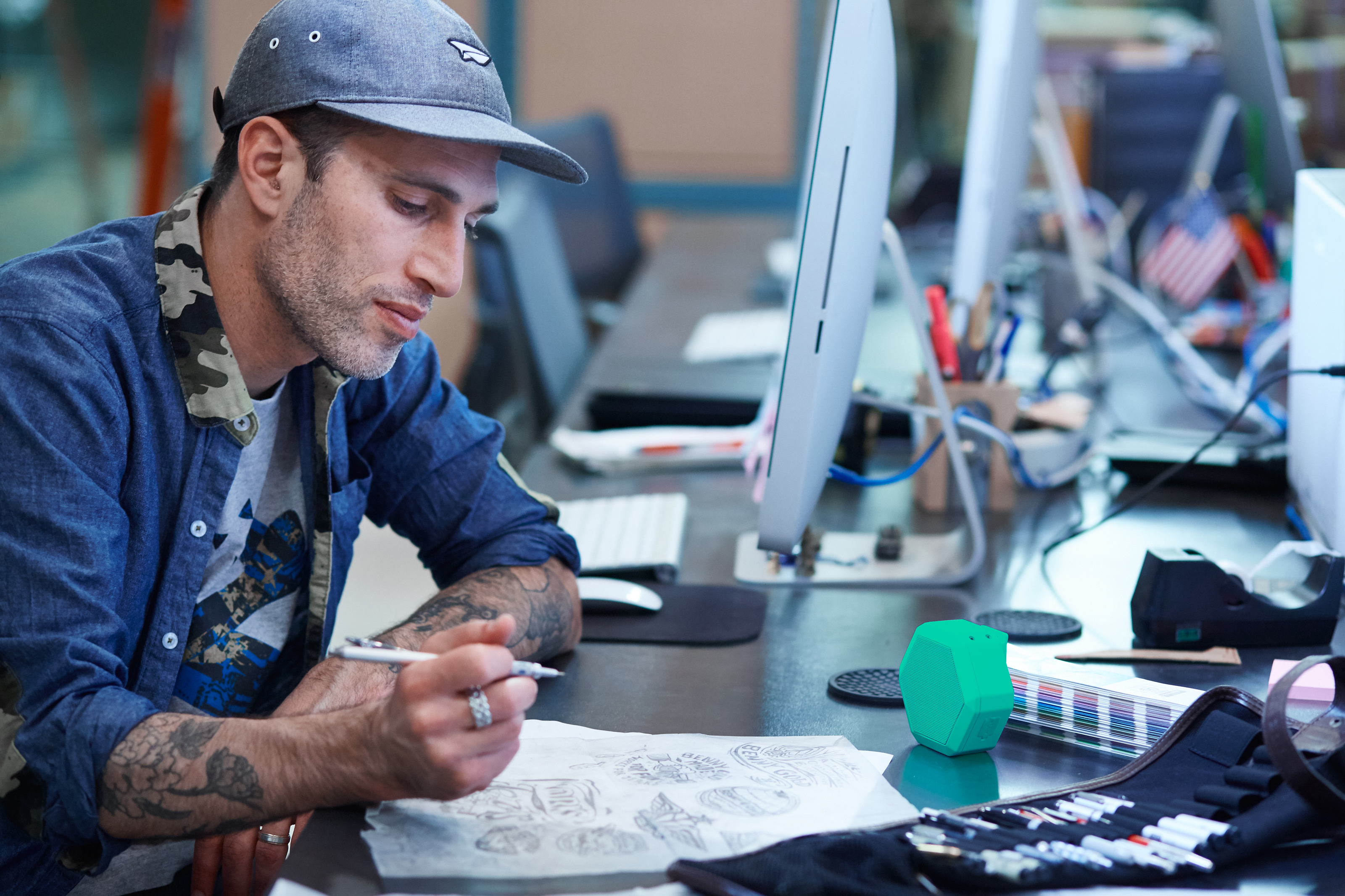 Benny Gold working on logo illustrations on tracing paper