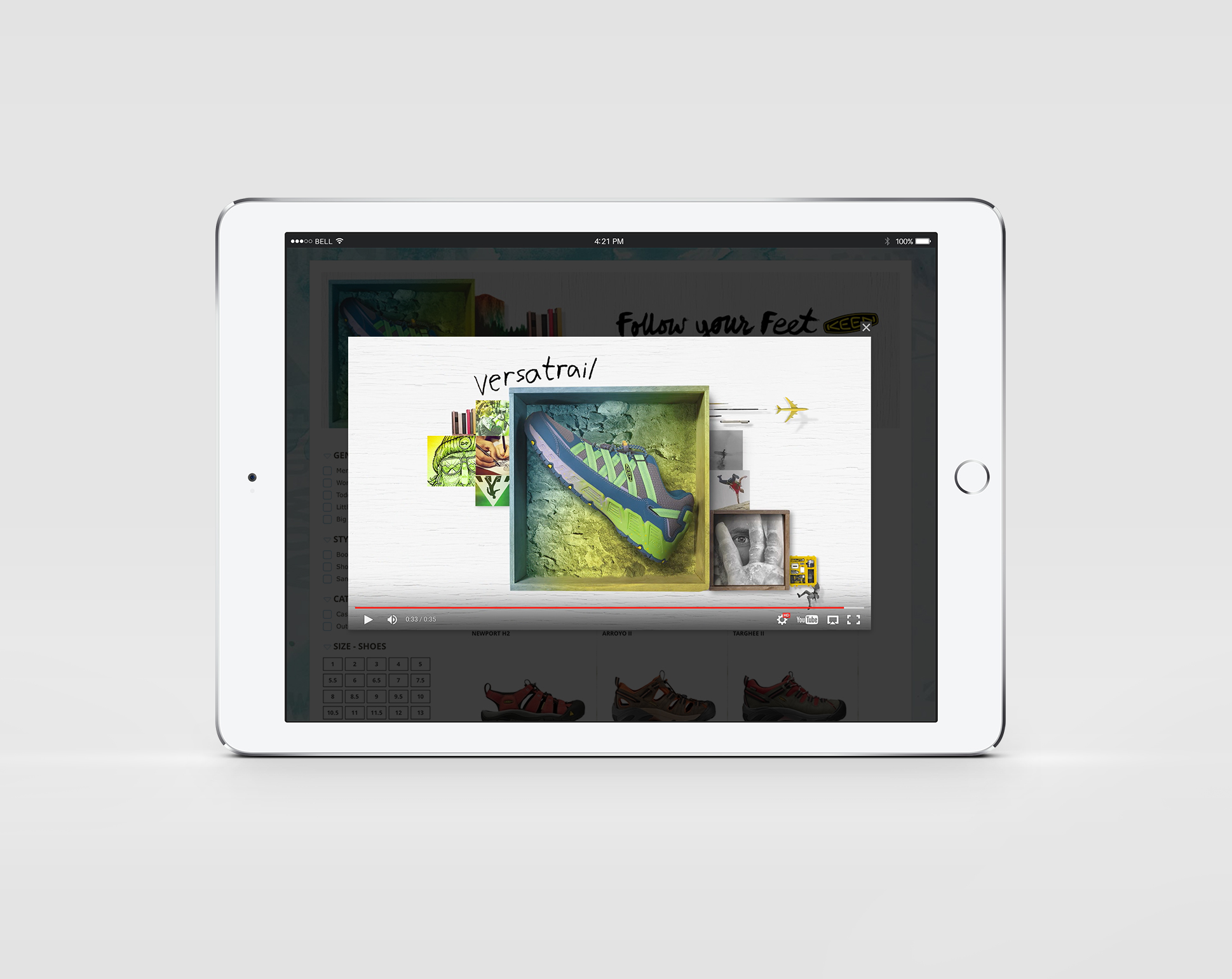 Youtube video for Keen that shows the beautiful arrangement of photography and framed images with flowers and beach related items with KEEN logo on smart tablet
