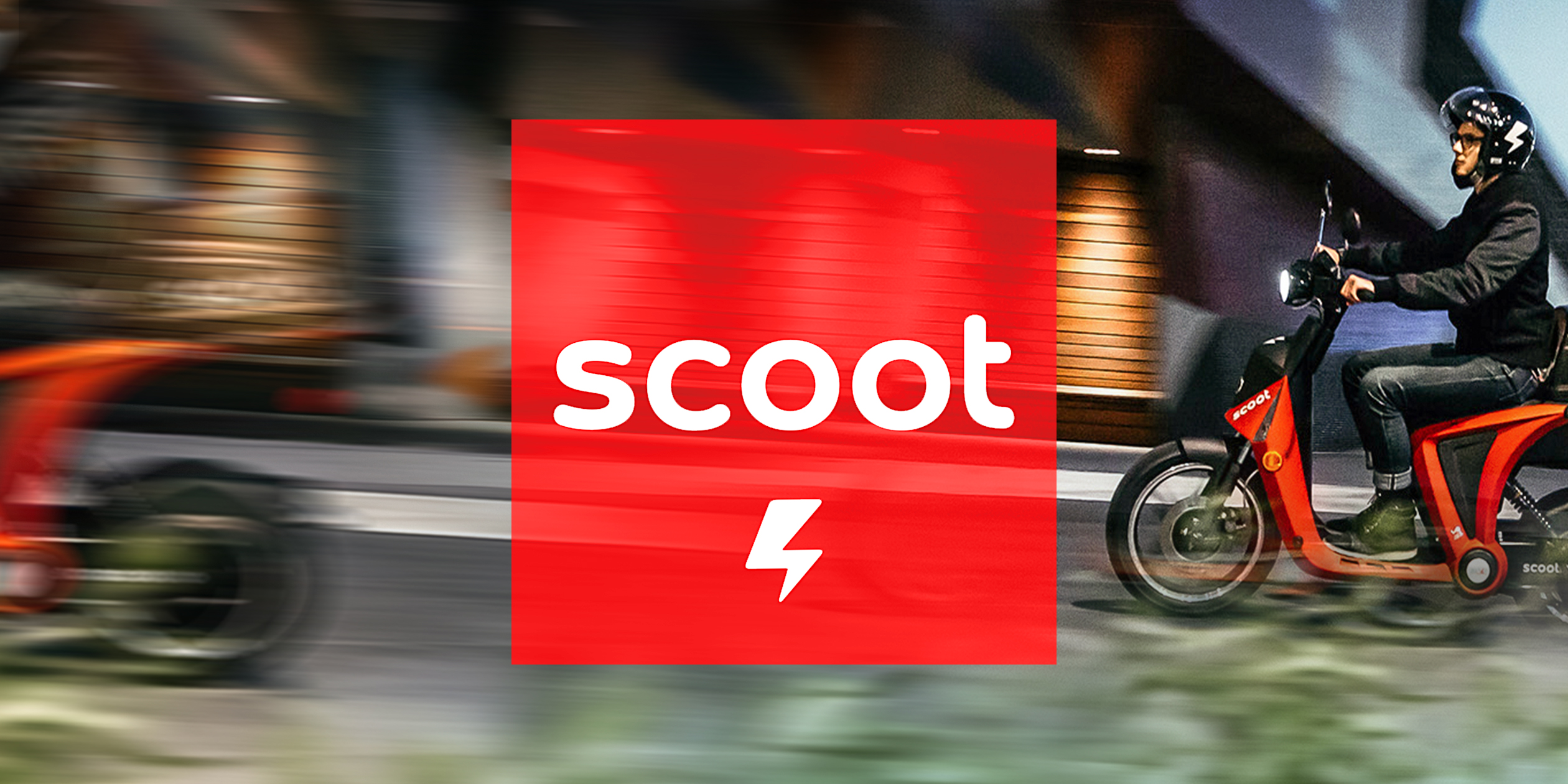 Person riding  on Scoot scooter bring cropped slightly out of frame as to emphasize movement