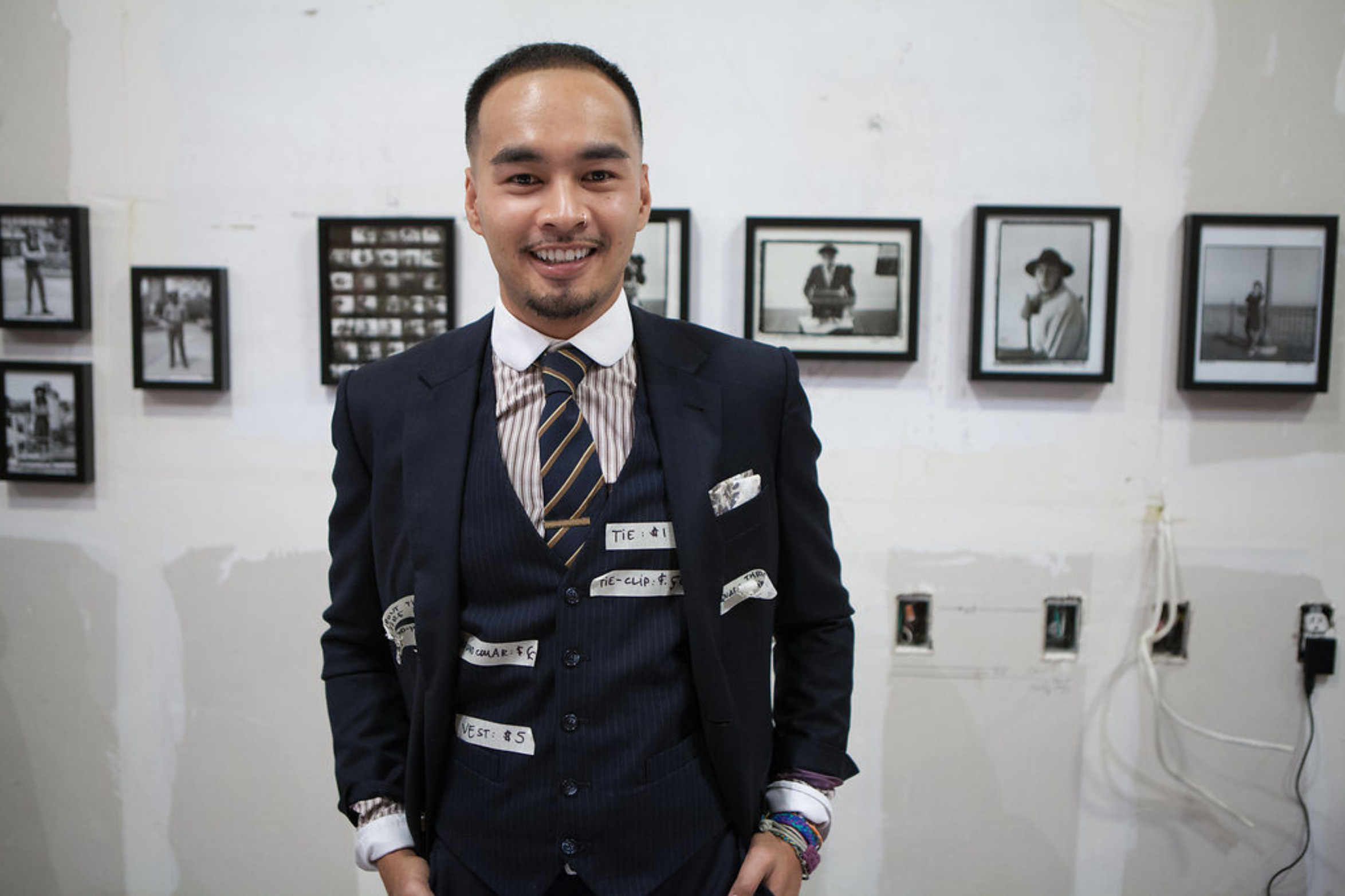 Portrait of man standing in front of body of photography work
