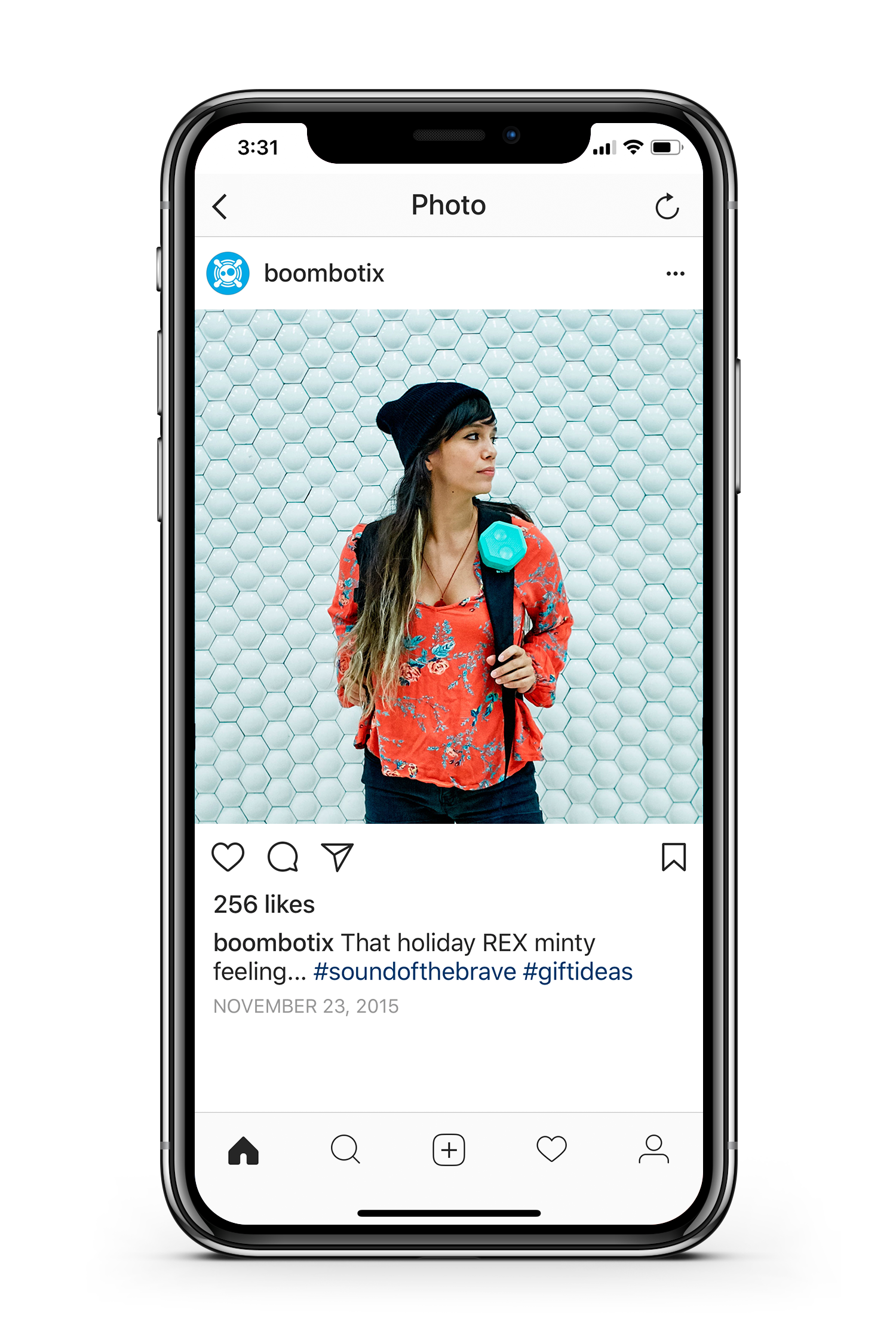 Boombotix instagram post of girl wearing speaker on backpack being displayed on a smartphone