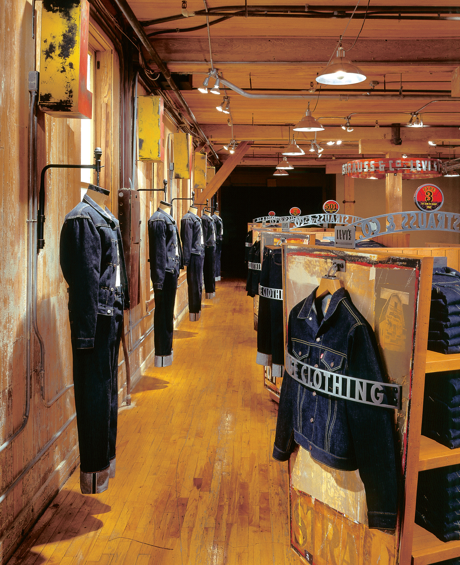 Levis retail store display with stunning black and white graphics and imagery and product shelves for denim.