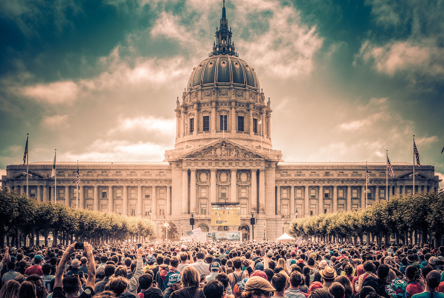 Outside San Francisco City Hall with crowd in front