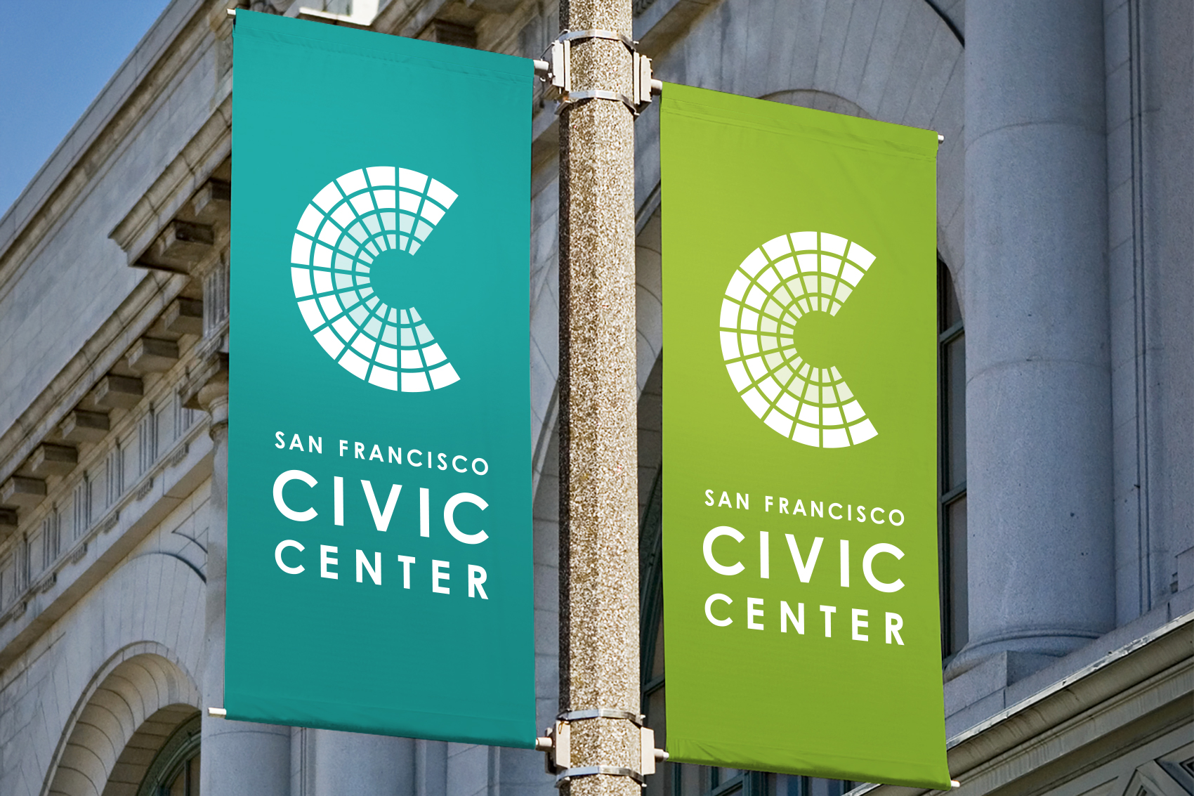 Blue and green San Francisco Civic Center street pole banners with white logo