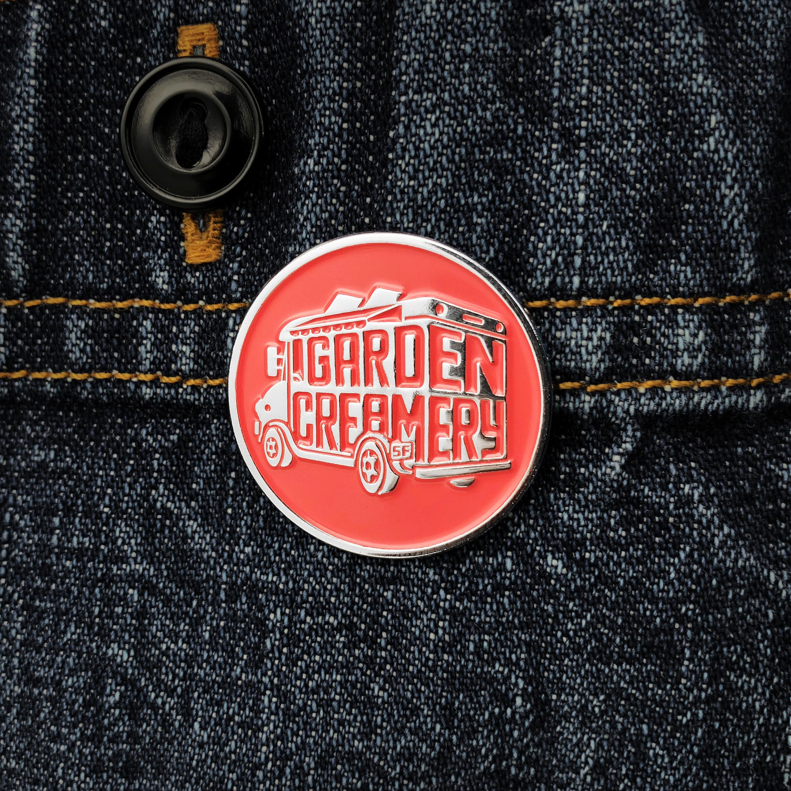 Garden Creamery logo pin on denim jacket