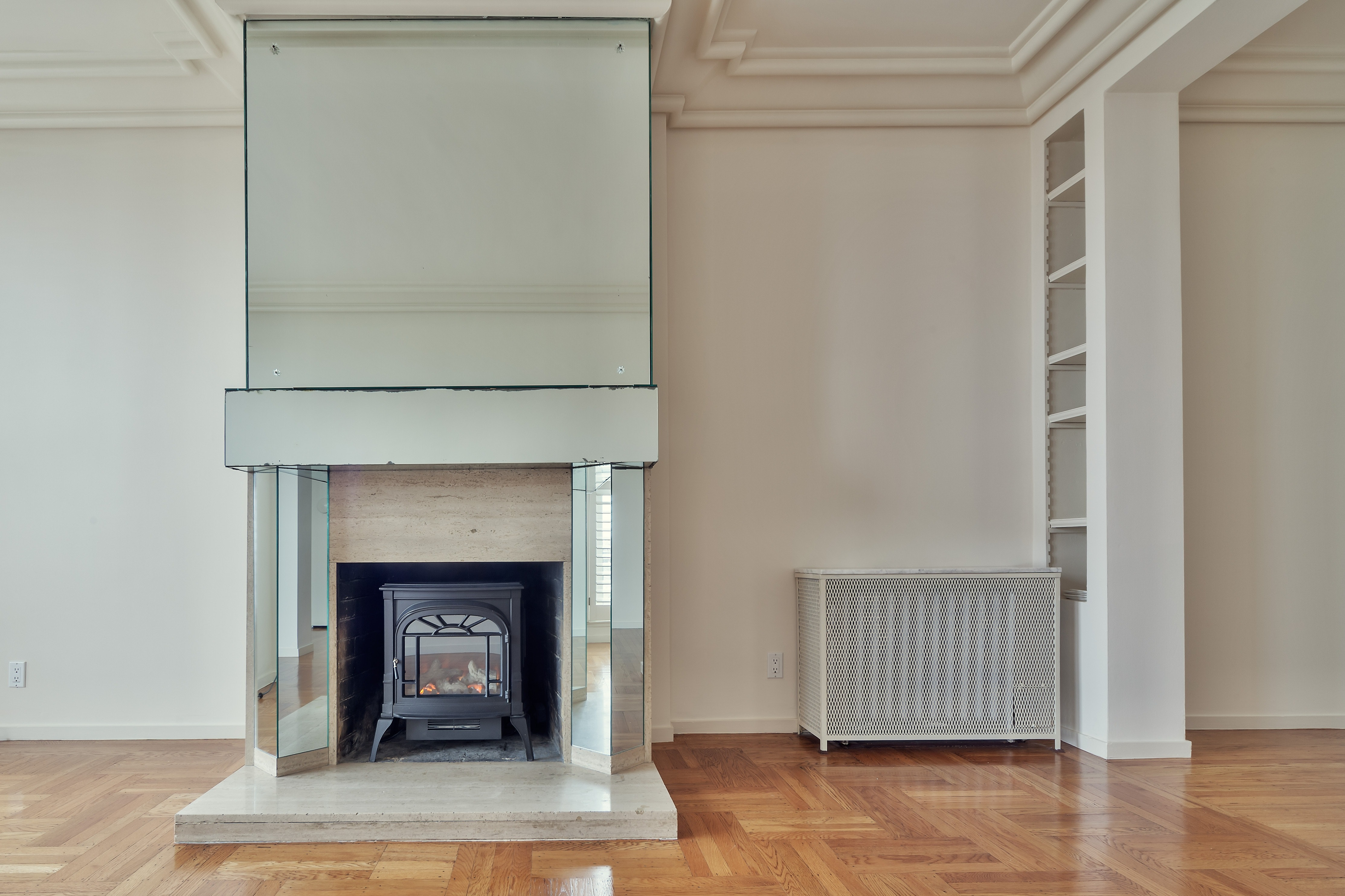 Empty living room with fireplace.