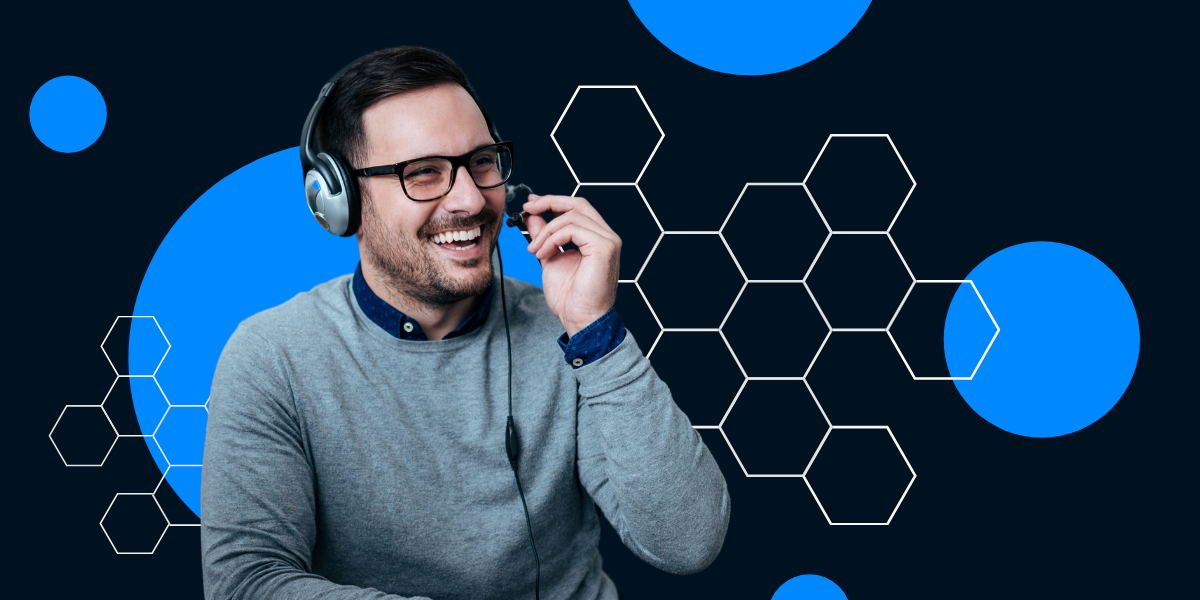 Man happily assisting a client through his headset